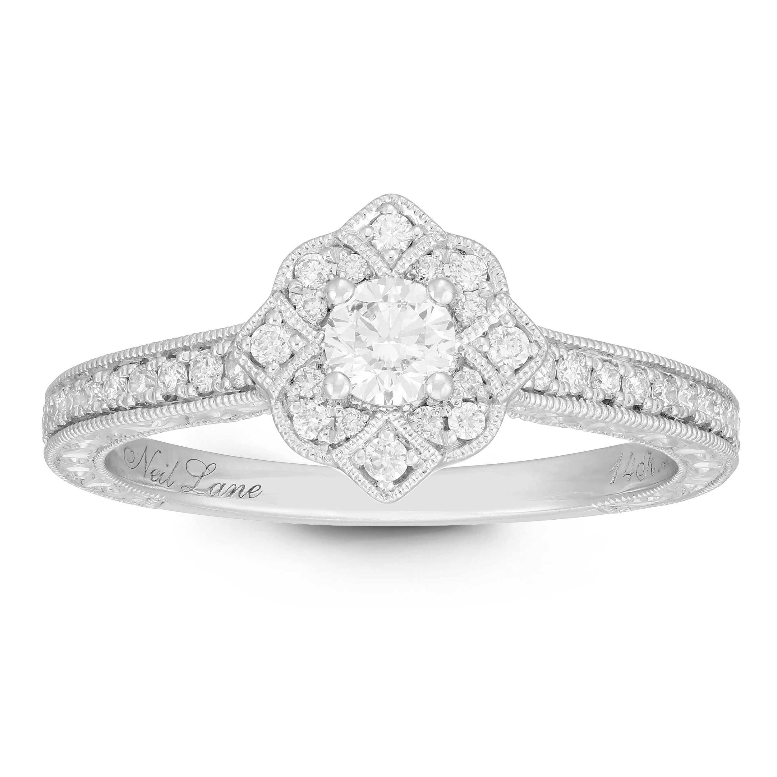 a692f66b7 Crafted in 14ct white gold this Neil Lane ring features a timeless Tudor  rose design, with a round-cut diamond center-piece. #diamonds #engagement # ring