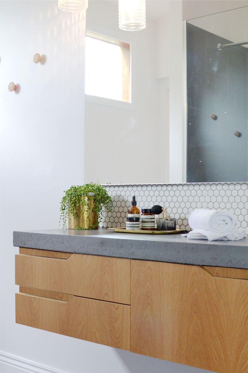 hexagon splashback, grey floor tile, cement like benchtop, timber ...