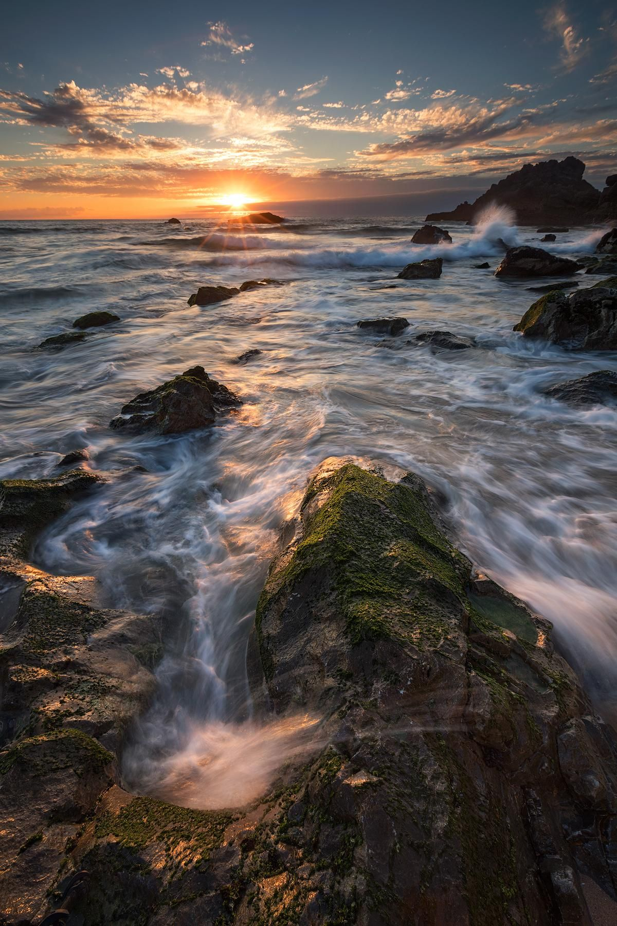 Dance of waves during setting sun on the coast of the