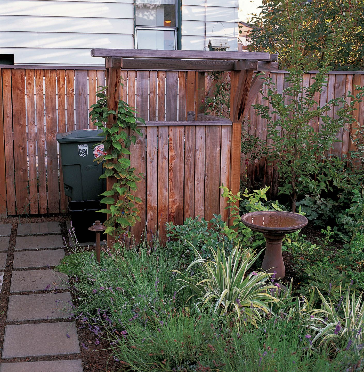 Nice Vertical Board Fence. Hidden Trash Can. Danger Garden
