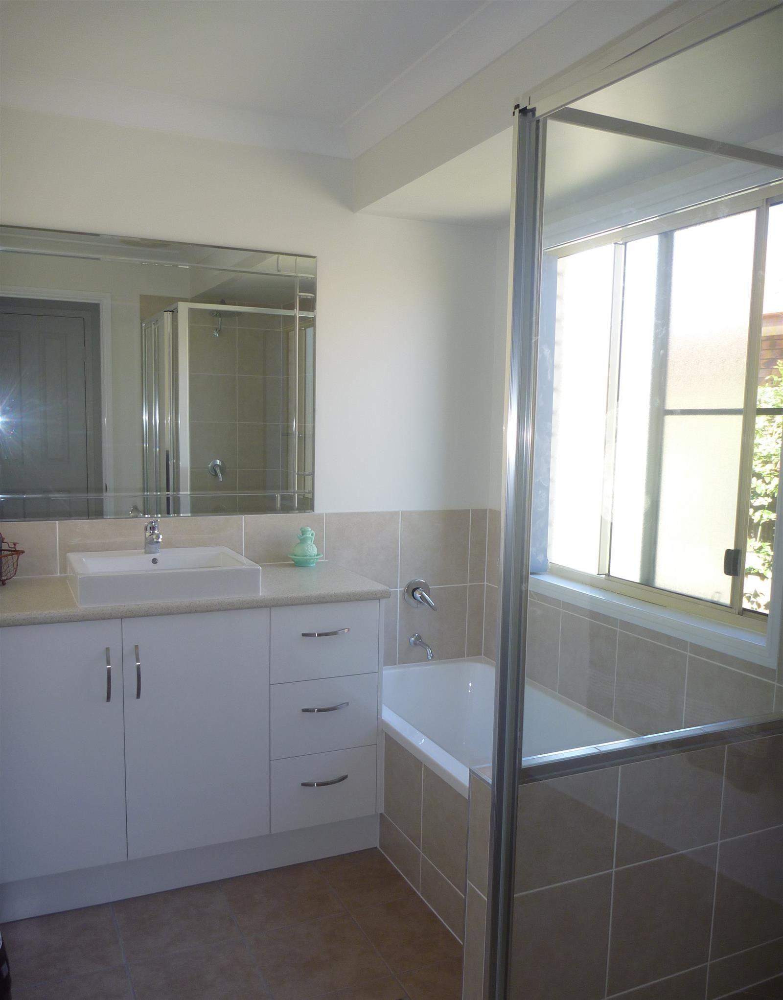 New modern bathroom with plenty of storage! @smithandsonsqld #renovation #bathroom