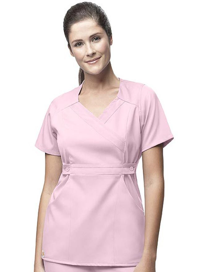 897c4db6e68 Style Code: (CA-C11202) Flatter your silhouette with this shapely solid  color Carhartt scrub top. It comes with a mock-wrap design that hugs the  body.