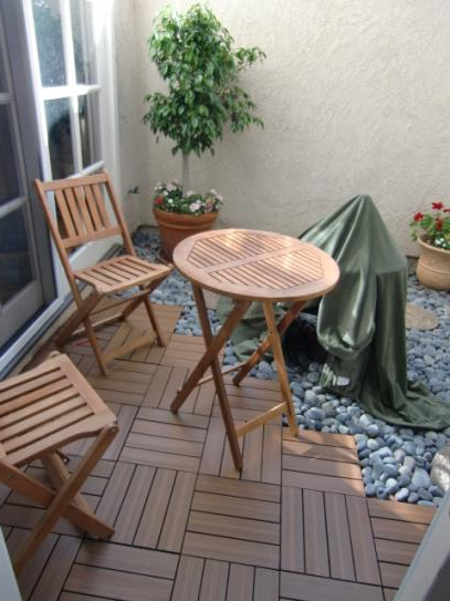 wood deck tiles with river rock edge | wilson | pinterest | wood