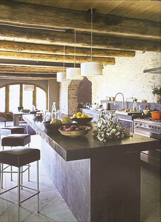 A modern rustic kitchen in a renovated barn in france for Modern barn kitchen