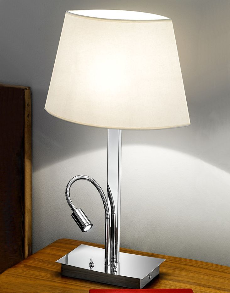 The Franklite Elliptical Table Lamp Is In A Modern Chrome Finish And Rectangular Section Design With LED Reading Light By