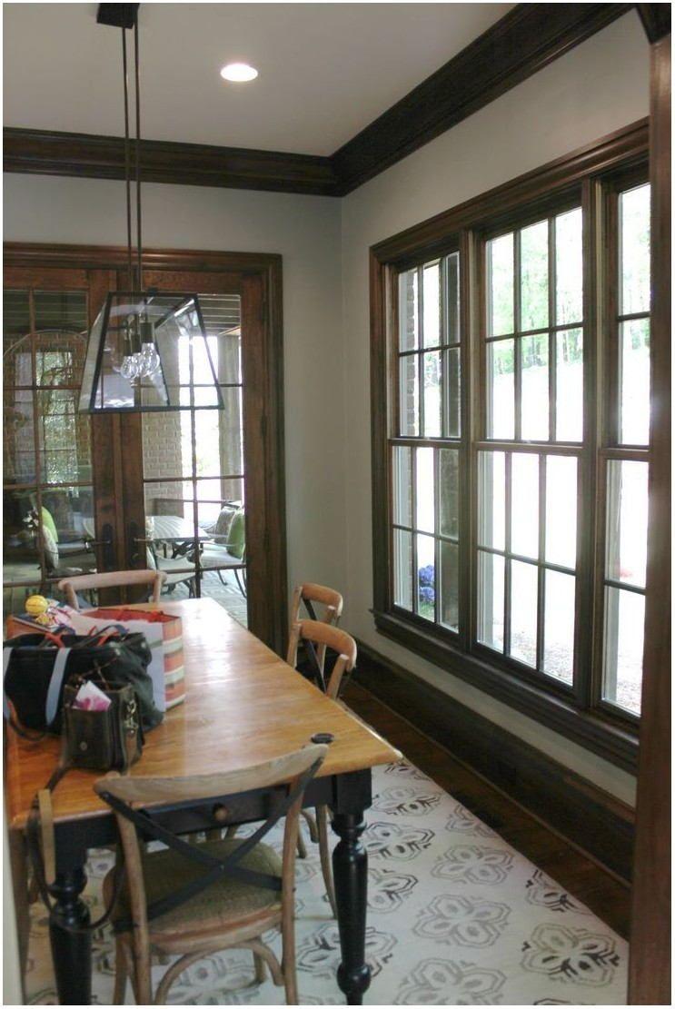 Pin By Jennifer Evola On Interior Decor Dark Dining Room Dark Wood Trim White Living Room Paint Colors