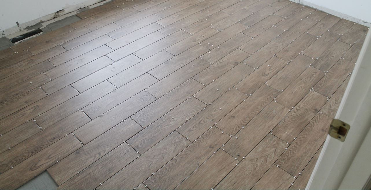 Ceramic tile floor diy floor pinterest ceramic tile floors tips for achieving realistic faux wood tile dailygadgetfo Image collections