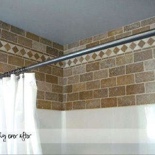 Bathroom DIY - tile looks beautiful above the tub/shower combo
