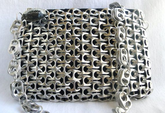 This is a very ecofriendly purse made from the pull tabs of recycled aluminium cans carefully chained and hand sewn to a black plushy fabric.