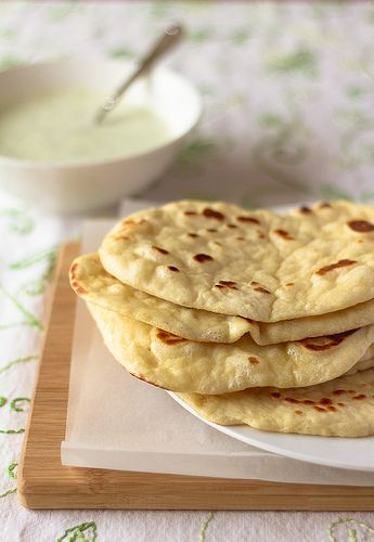 How to Make Naan Bread - delicious, fragrant and fresh - you will never buy the ones at the supermarket again. Freezes very well.  canuckcuisine.com