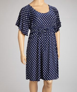 Playful polka dots take this fun frock from staple to standout. With its fluttery angled sleeves and curve-contouring drawstring waist, this pretty piece flaunts flirty fashion while maintaining a polished look.