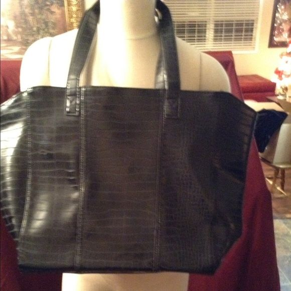 Neiman Marcus Bag. NWOT Black Neiman Marcus bag is super cute. Big and comfortable and ready to carry a lot of things. Perfect to carry books or clothes or anything that you need to take with you. This bag will be a needed staple. My favorite bag to go to!! Neiman Marcus Bags Totes
