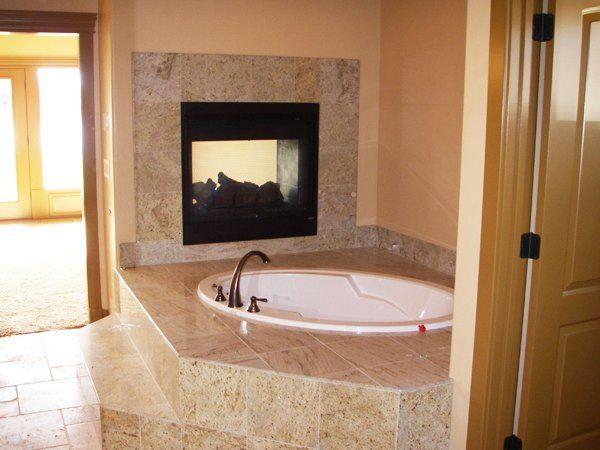 Soaker tub near fireplace