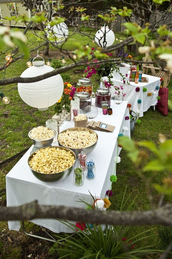 backyard movie screening tablescape full of popcorn and movie theater treats party wedding. Black Bedroom Furniture Sets. Home Design Ideas