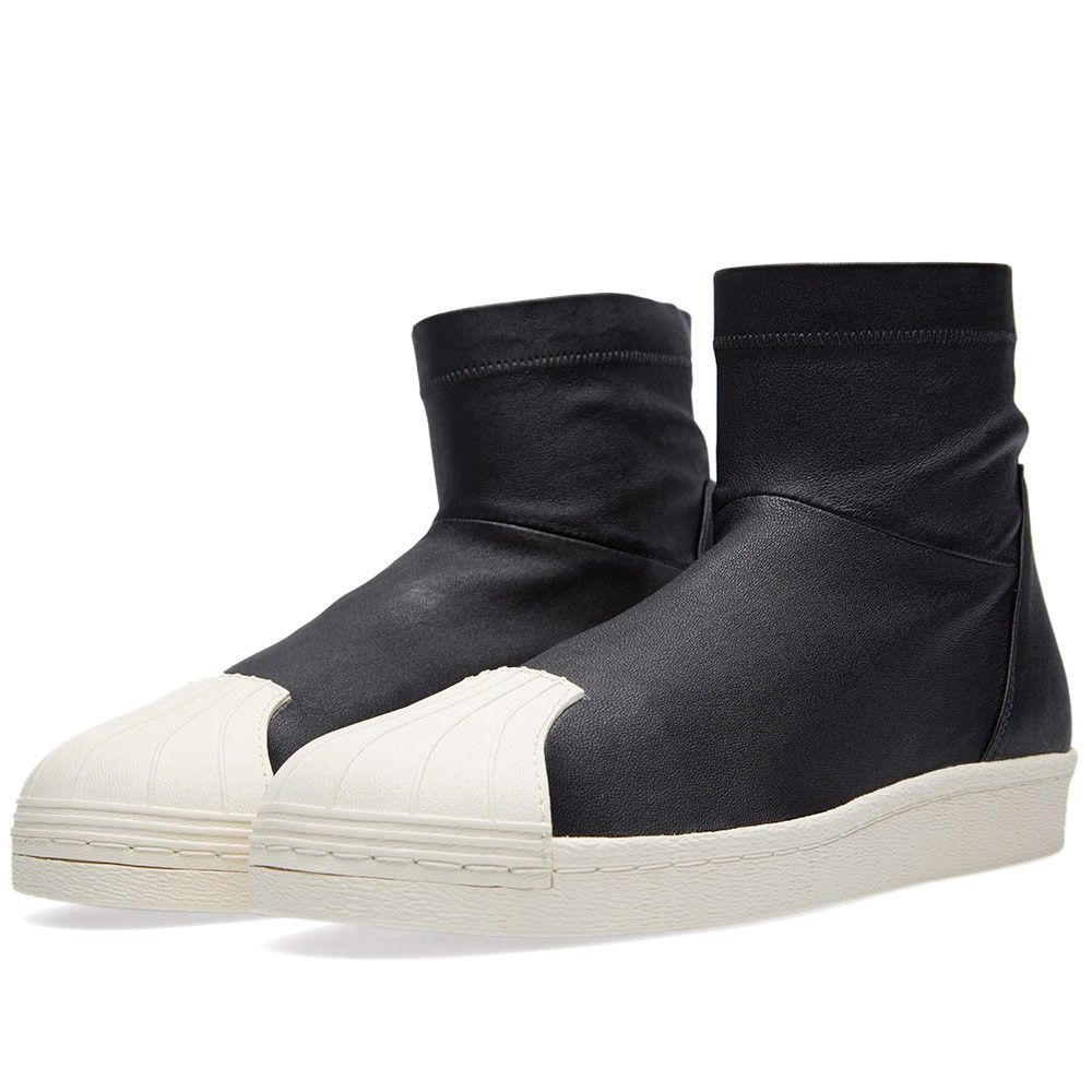 High-top sneaker in dark grey suede leather with contrasting white accents  and rubber sole. High tongue and padded back ankle. Side zip closure at …