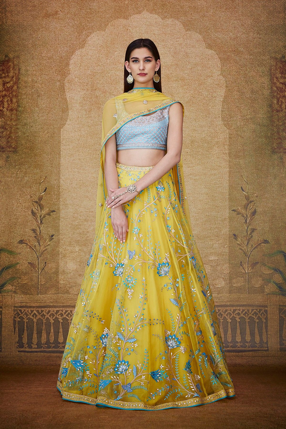 55c40542872 A powder blue silk choli paired with a yellow organza A-line lehenga with  minimal touches of blue