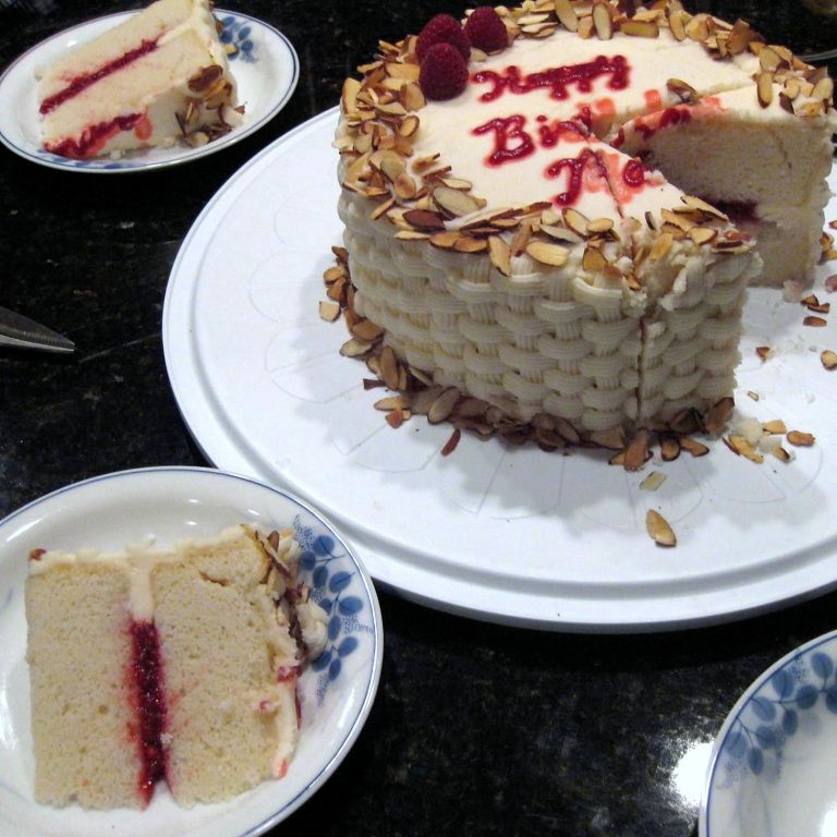 White Almond Cake With Raspberry Filling And Vanilla Buttercream