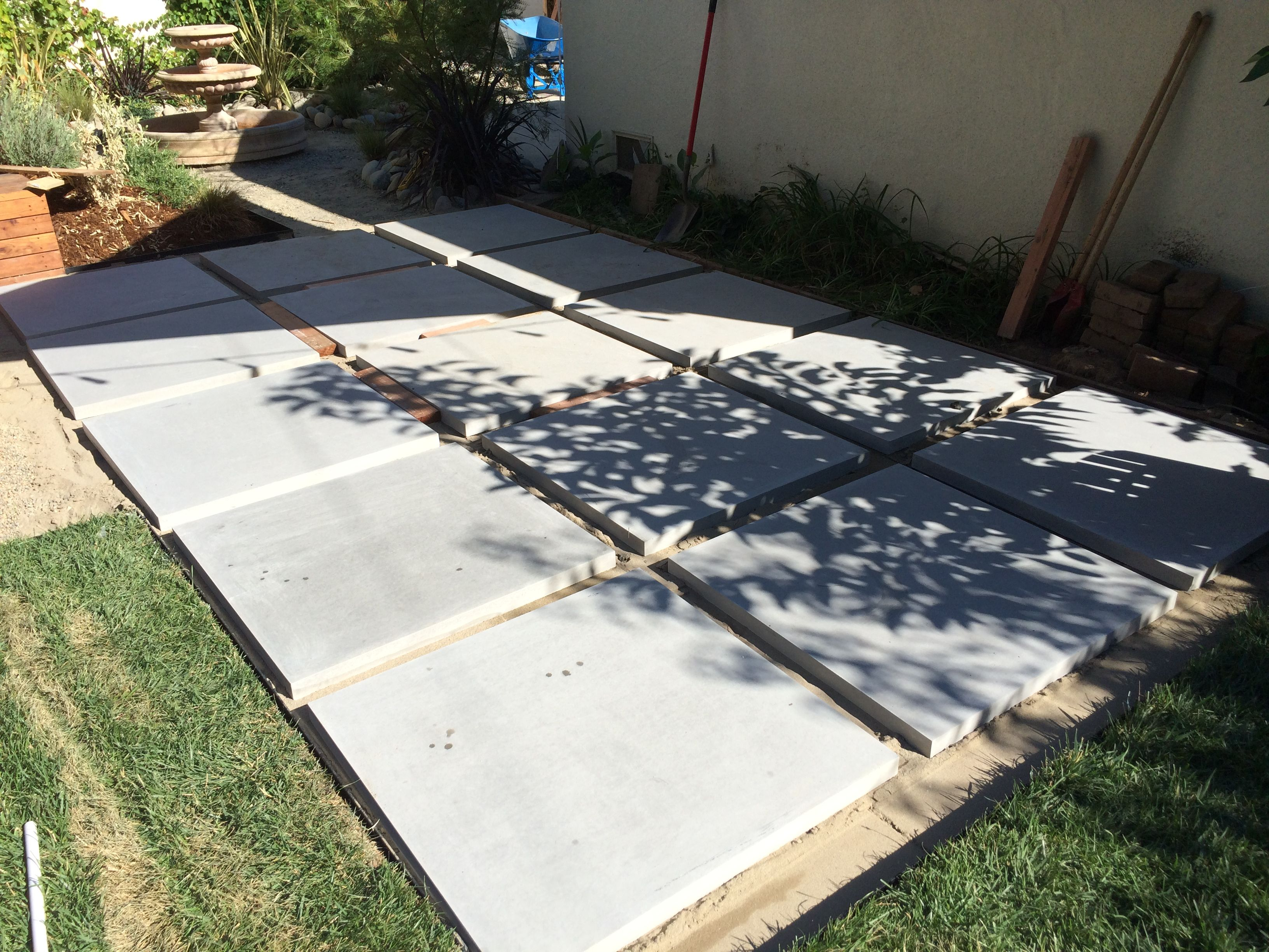 These 36 Square Slab Pavers Are Perfect For A Diy Patio That S Modern Yet Timeless I Used A 2x4 To Creat Even Gaps Patio Pavers Design Paver Patio Diy Patio