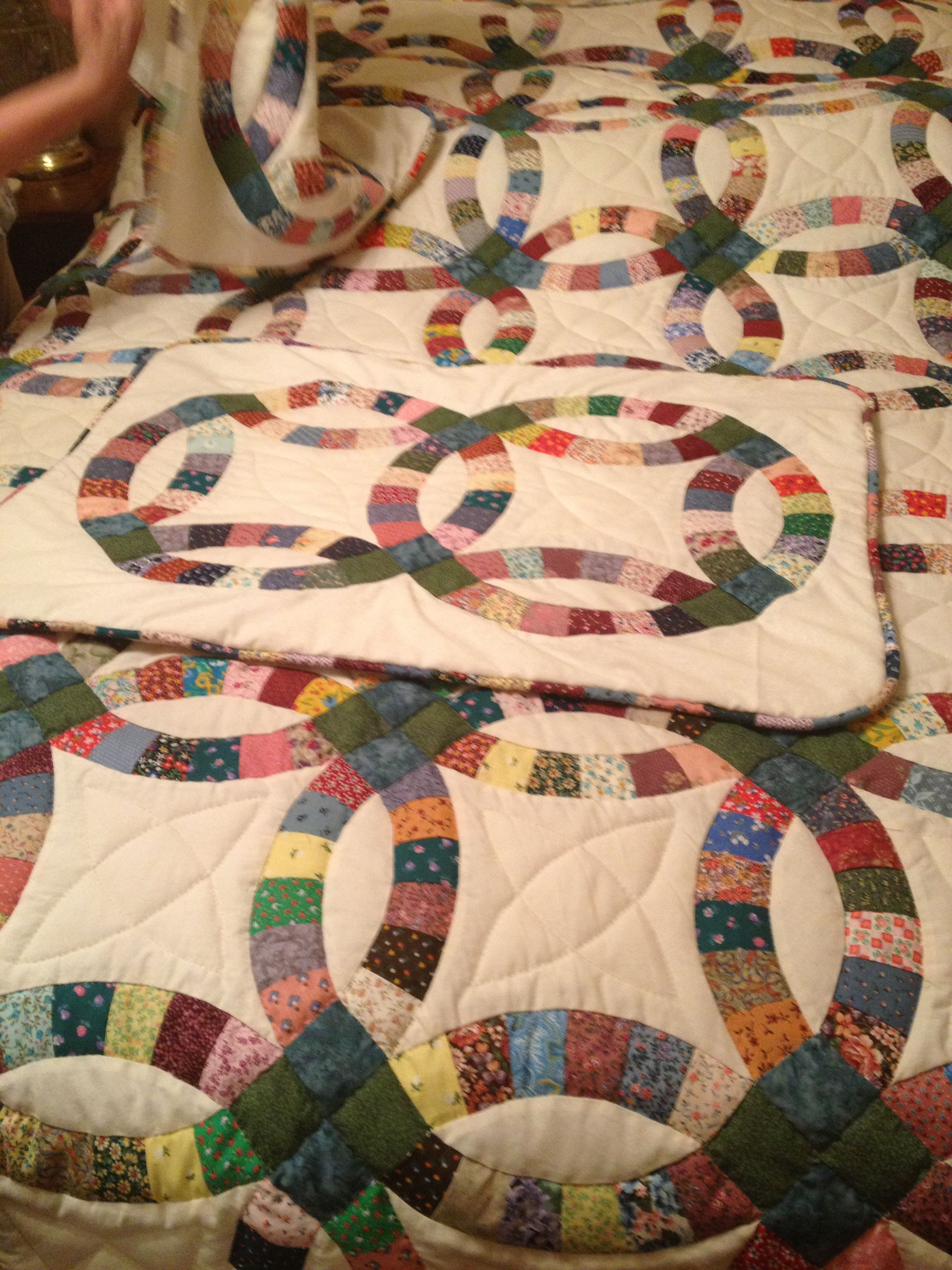 Double wedding ring quilt with pillow sham made by Grandma Josie