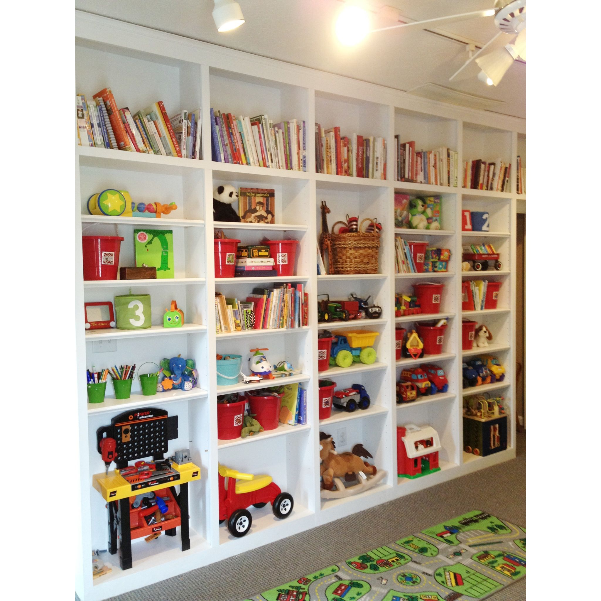 our playroom organized shelves with buckets from