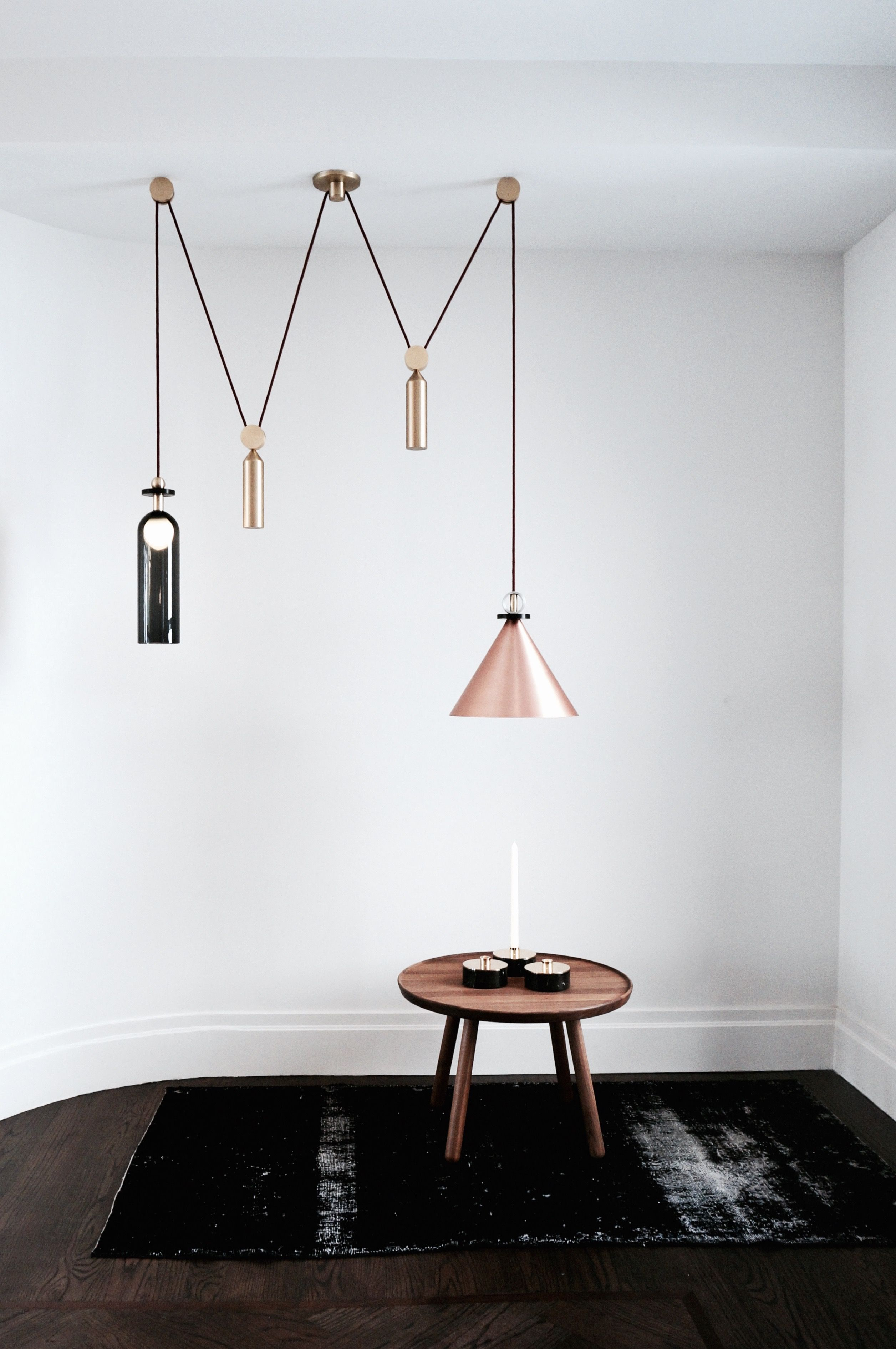 Minimal living room with a stunning ceiling lamp. Coffee Table in ...