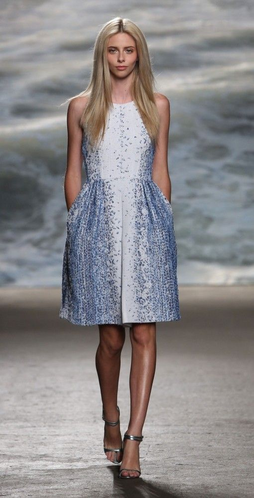 Mady from Rolando Santana.  This classic white and blue ombre tweed sleeveless fit and flare dress is sure to make a statement at your upcoming summer event. With a youthful racerback exposed back zipper, fitted bodice and playful full skirt, this dress promises a flattering fit. Simple summer reception? Style it with metallic silver sandals and you are set to go.