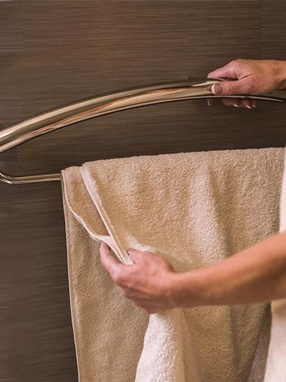 Combination Toilet Paper Holder And Grab Bar For Small Bathroom: Combination Grab Bar/towel Bar Being Used