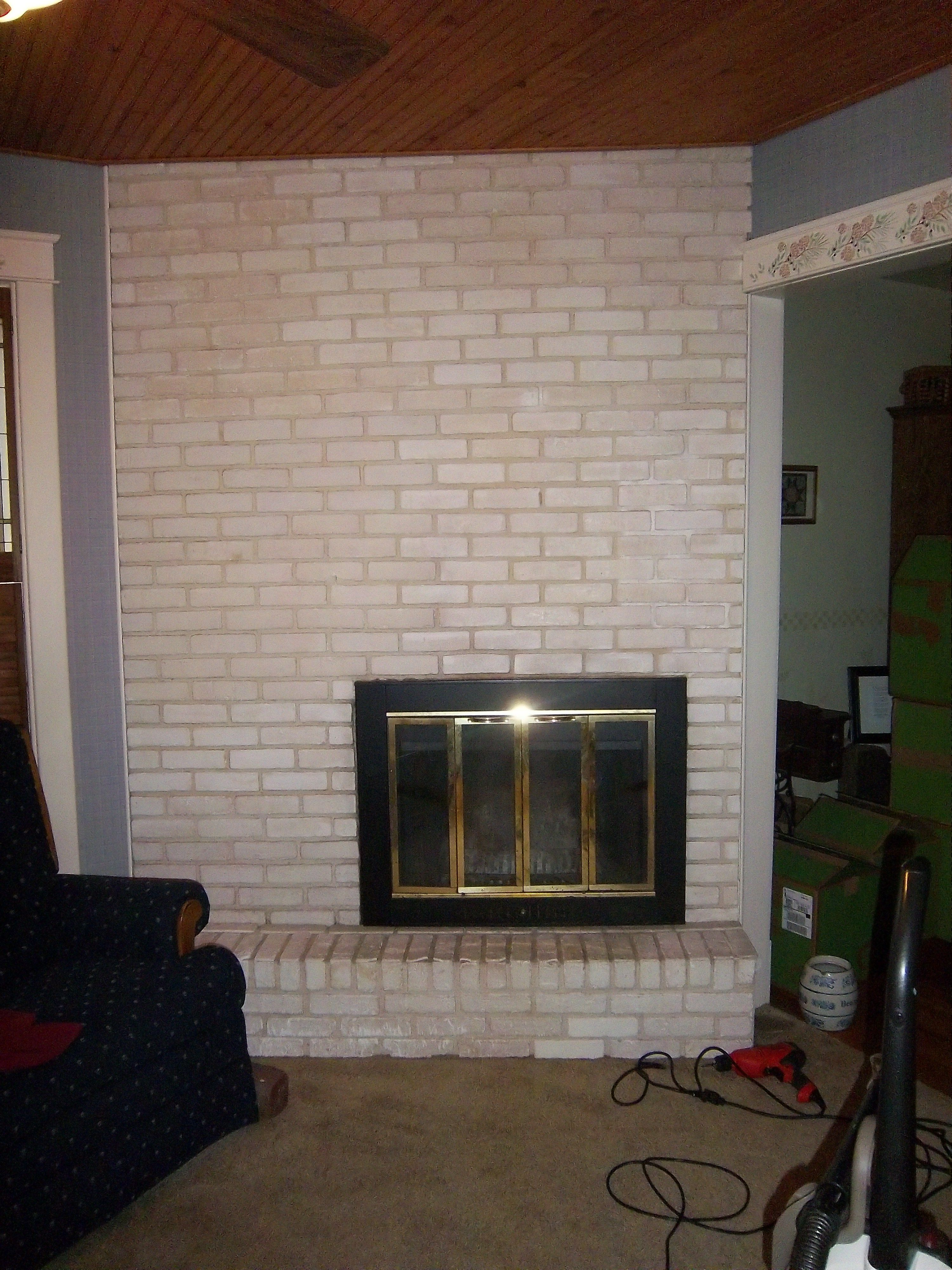 White fake brick fireplace, just beginning to repaint ...