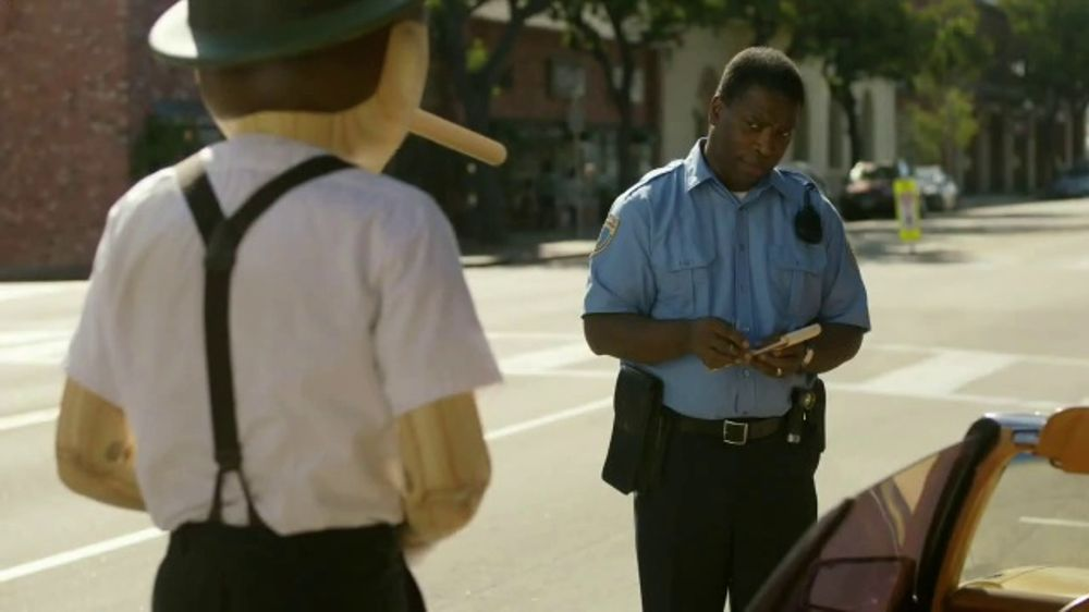 As A Police Officer Begins To Assign A Parking Ticket To Pinocchio