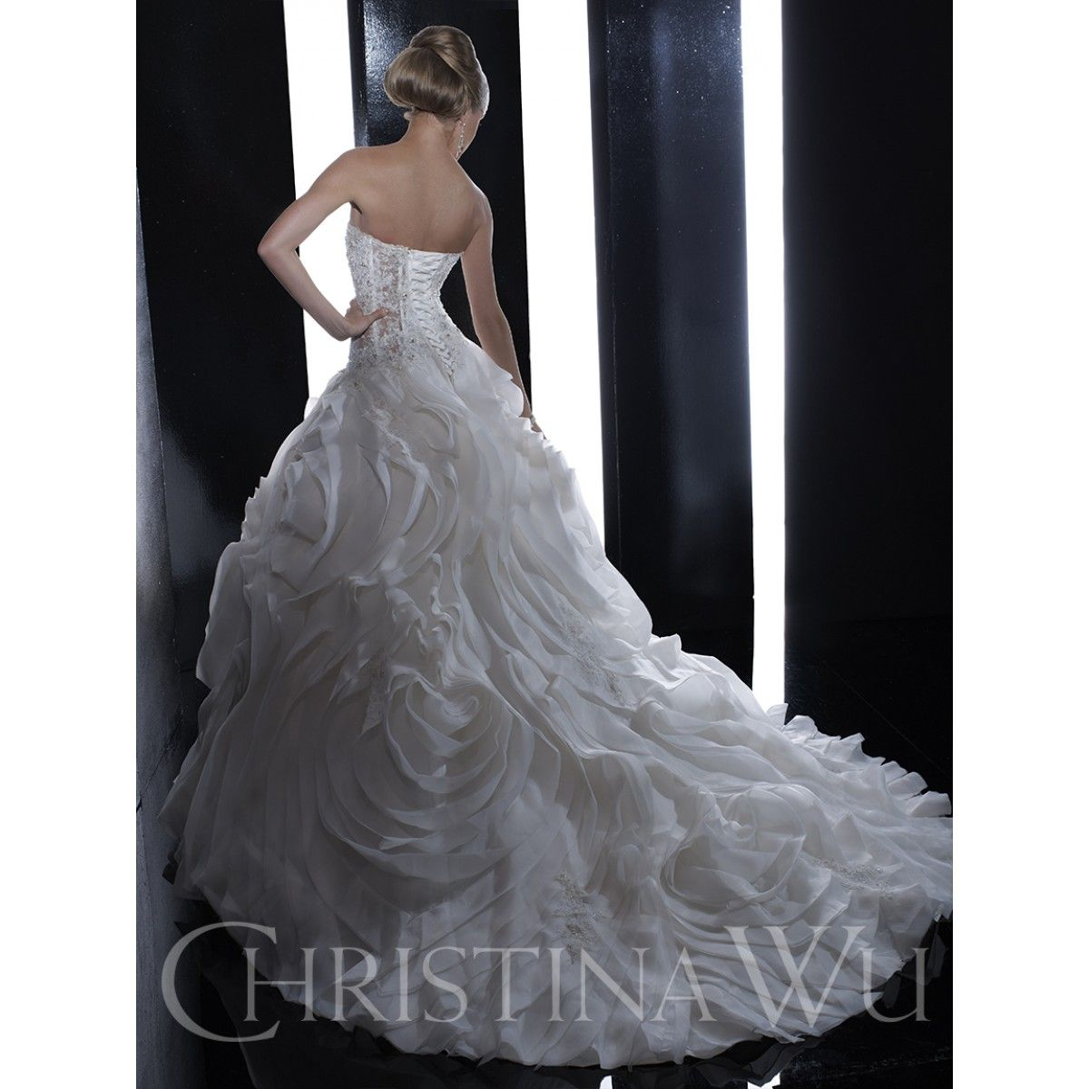Covered shoulder wedding dresses  Christina Wu Style  is a strapless wedding dress featuring a
