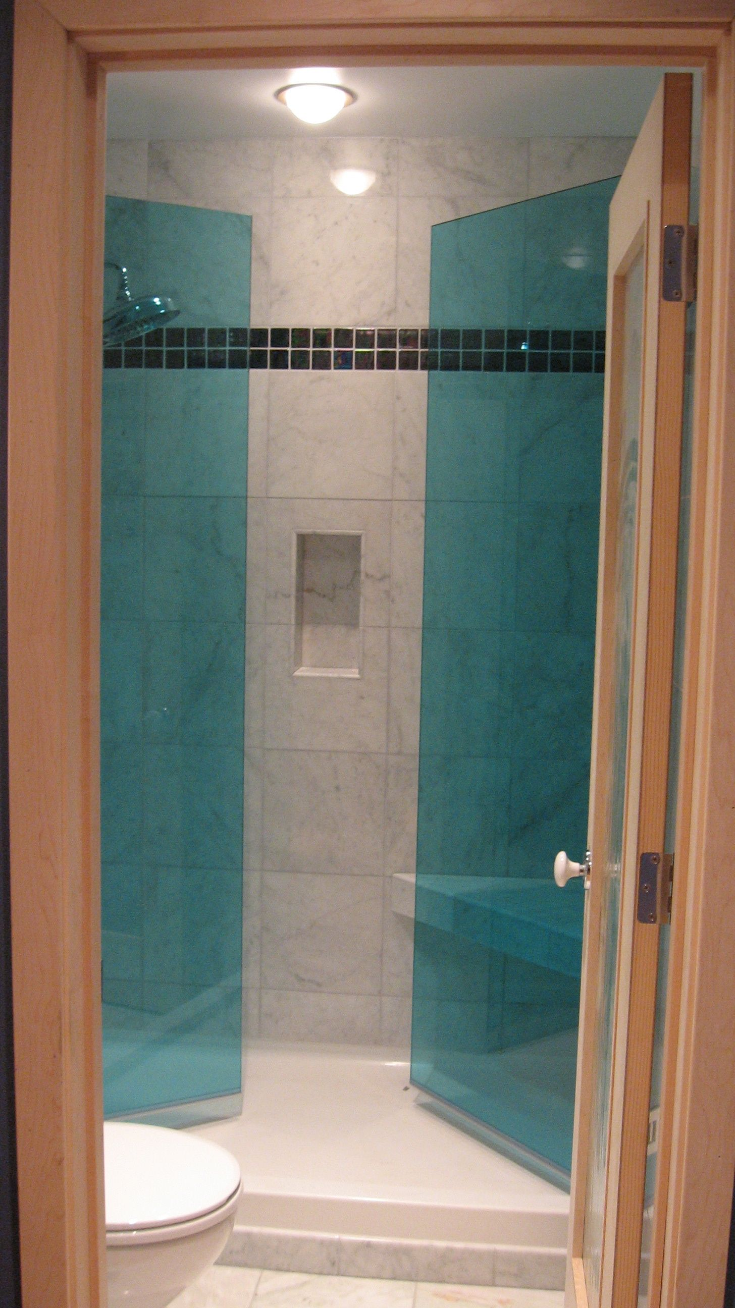 Harbor Bathroom Project. Frameless blue glass shower doors. These ...