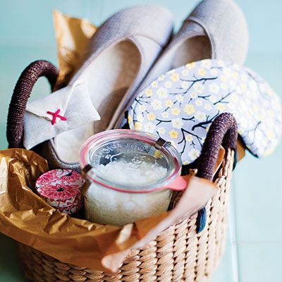 A spa-inspired handmade gift basket:  Sugar scrub Lavender sachet Travel candle Eye mask Slippers