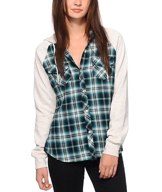 ab70ced52e7 A slim and fitted teal flannel body is finished with grey contrast fleece  raglan sleeves and drawstring hood for a comfortably stylish look you will  love.
