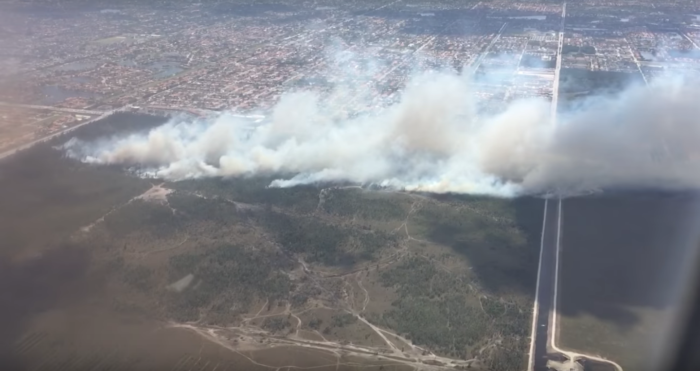 Captured from above, you can see that the fire that has now spread across 670 acres has created very limited visibility for anyone traveling or living in the area.
