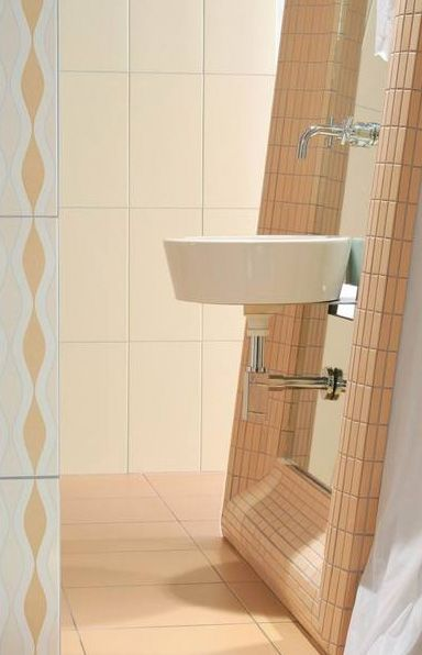 Interesting sink setup, love the tiled frame.  Rako - Czech tiles