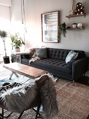 Living Room Jute Rug jute rug, tufted couch, dark grey couch, shelves above couch