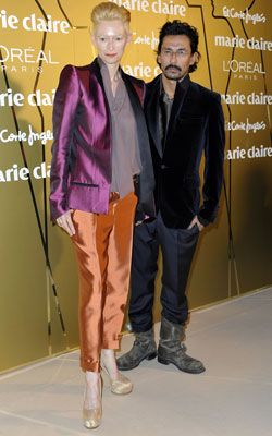 Tilida Swinton mixes an unusual combination of colours and metallic textures.at an award ceremony in Madrid