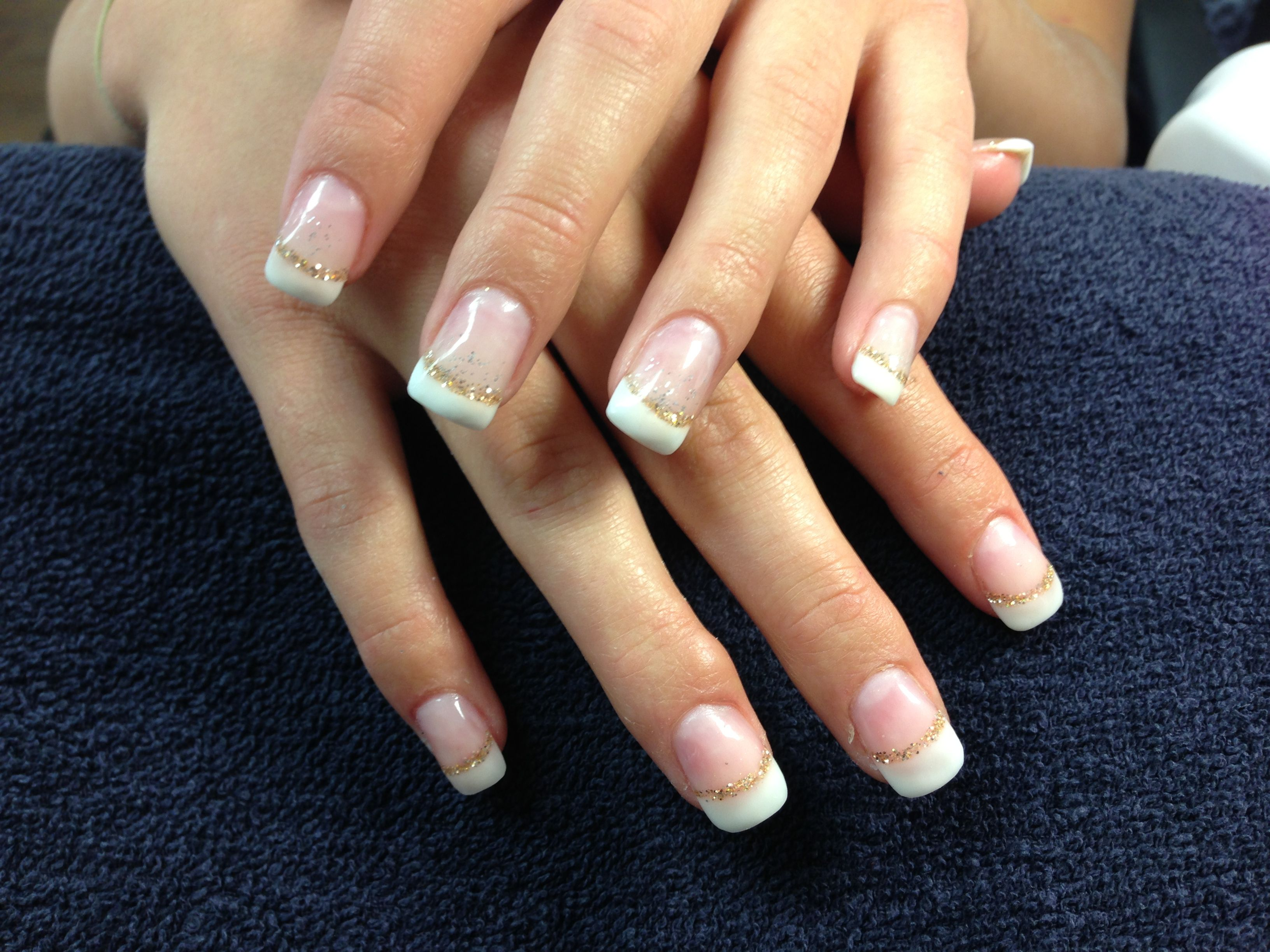 Laurel\'s nails. Simple French white tips with a gold glitter smile ...