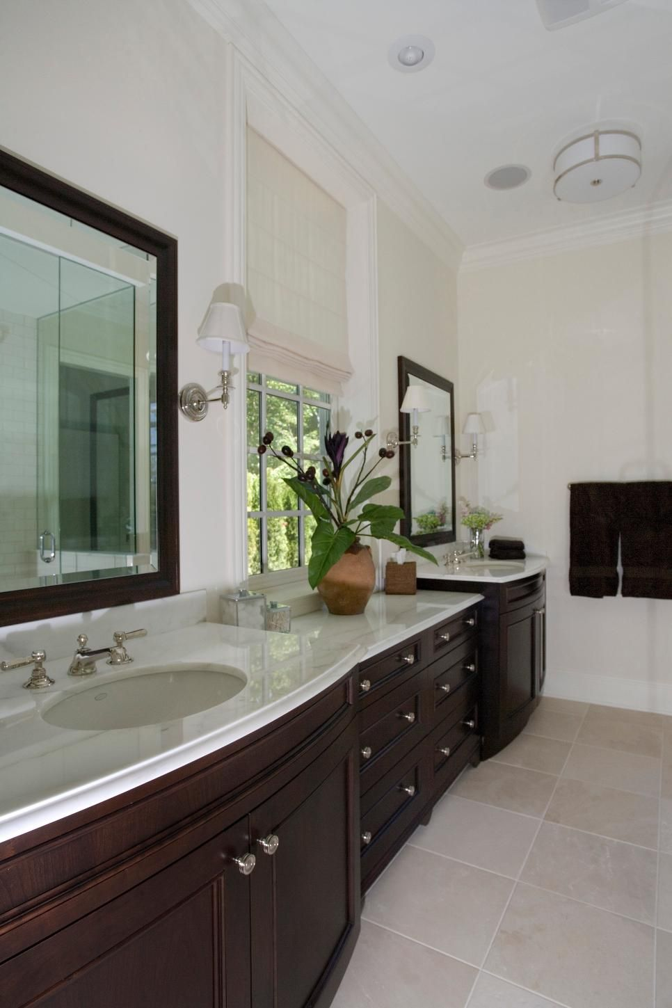 A Spacious Double Vanity With Dark Wood Cabinets And