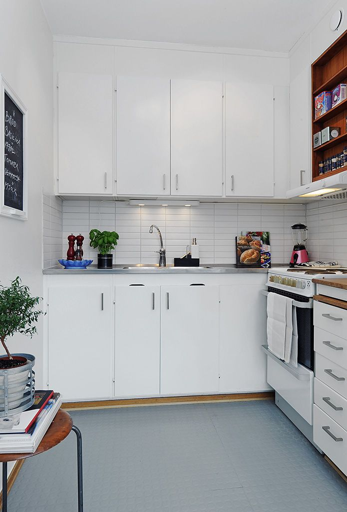 white kitchen with rubber flooring