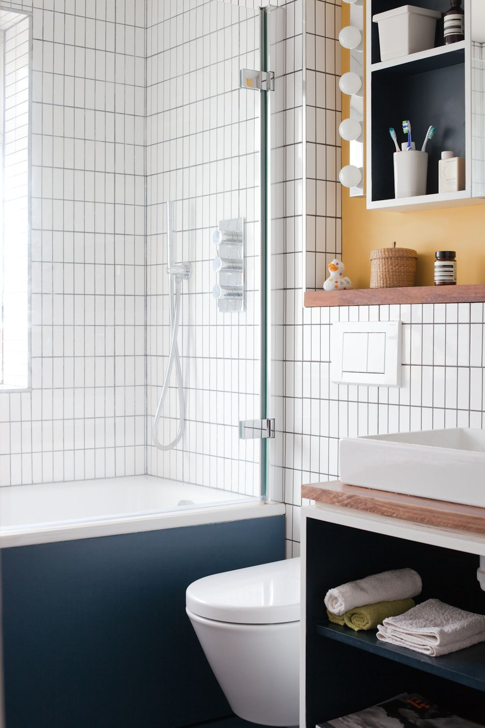 bathroom - blue linoleum, white tiles, Ikea lighting, Catalano ...