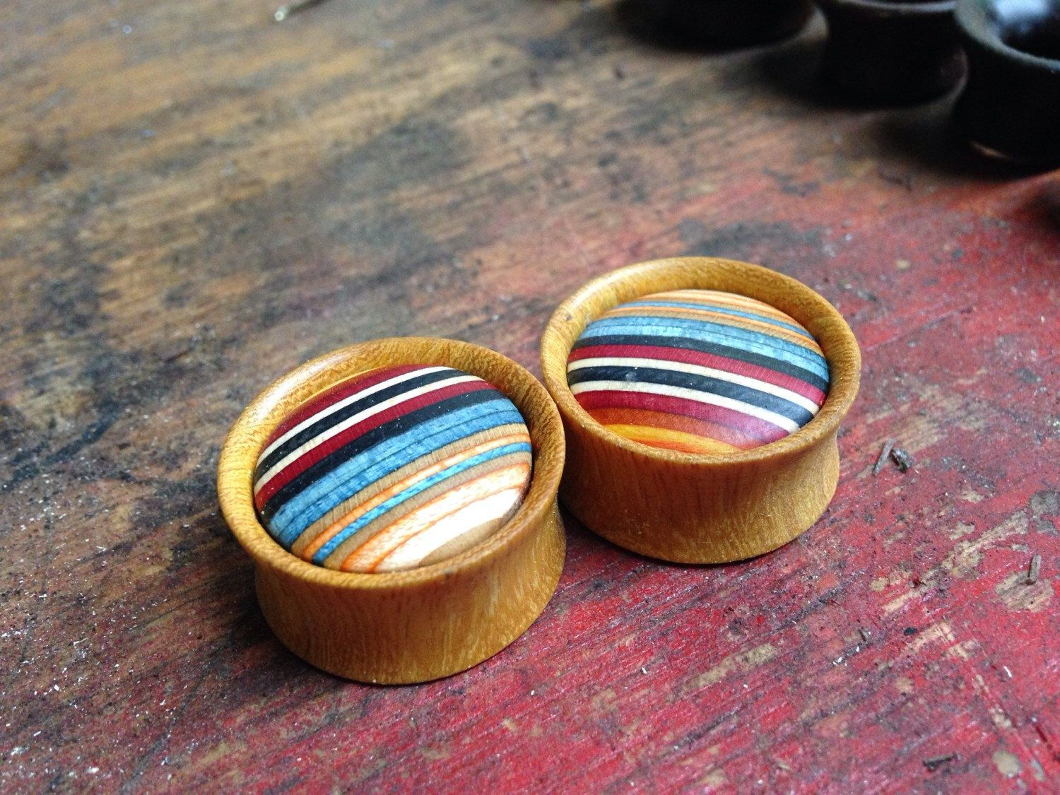 """Size 1/2"""" and material would be Chechen Wooden Plugs with Limited Edition BUBBLE CAB Skateboard Inlay by BarkandBole on Etsy https://www.etsy.com/listing/210498108/wooden-plugs-with-limited-edition-bubble"""