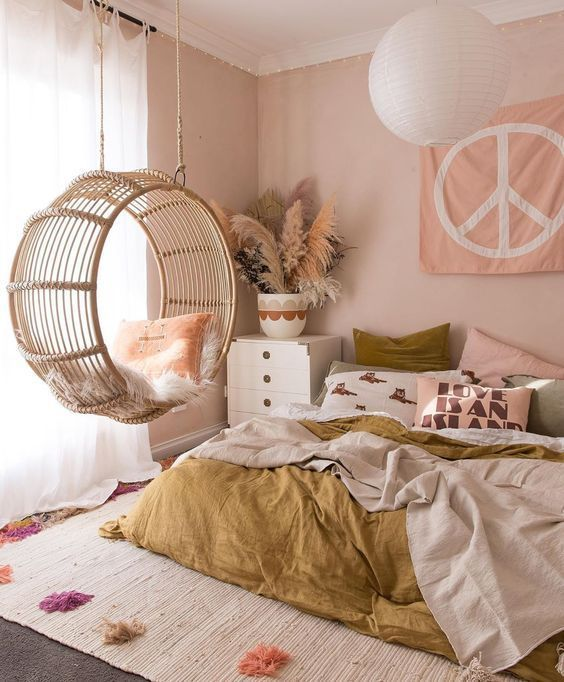 Photo of Pink & ochre bed room with spherical rattan hangin chair