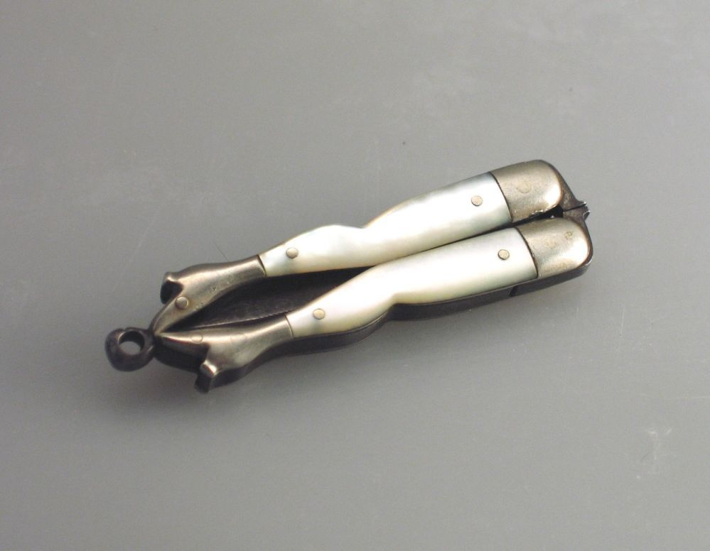 Vintage Miniature Ladies Legs Folding Scissors with Chatelaine/Fob Latch Well, here's an odd one...