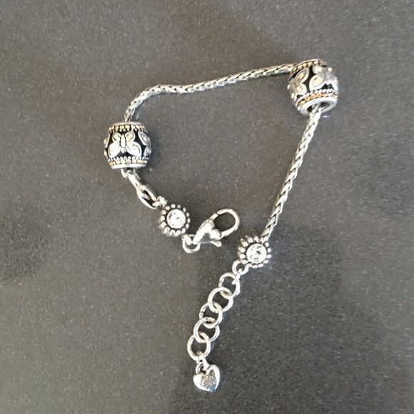 Brighton Swarovski Charm Bracelet Brighton Swarovski Charm Bracelet. NWOT never used. Charms shown in first picture are sold separately. Priced higher to get amount that I paid for it. Which was $35.00 plus tax. Brighton Jewelry Bracelets