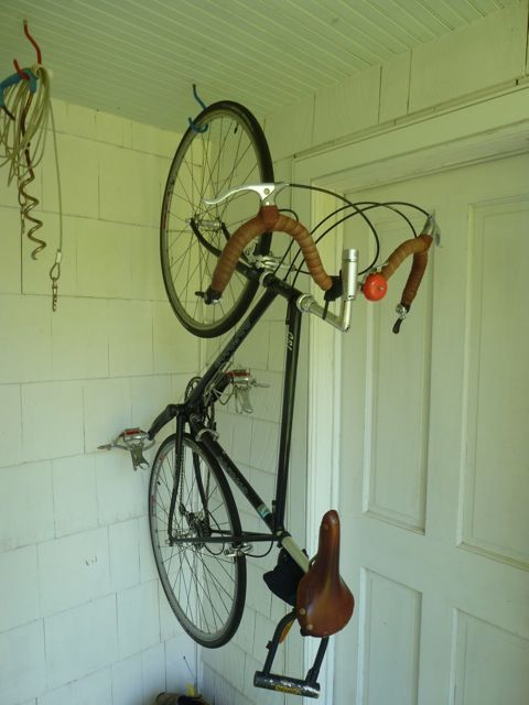 Bicycle Suspended From A Ceiling Hook In An Out Of The Way Corner Of A Porch Bike Storage Bicycle Storage Bicycle