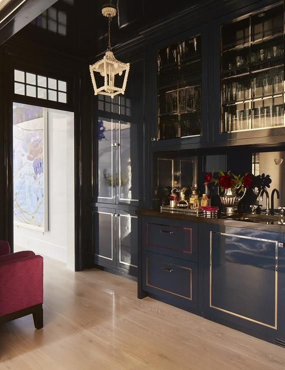 Chic Contemporary Wet Bar Boasts Blue Lacquered Cabinets Accented With A Gold Trim And Brown