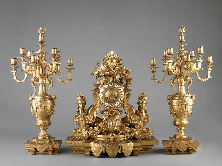 French neo-Louis XVI-style gilded clock with sphinxes and matching candelabra, late 19th century.
