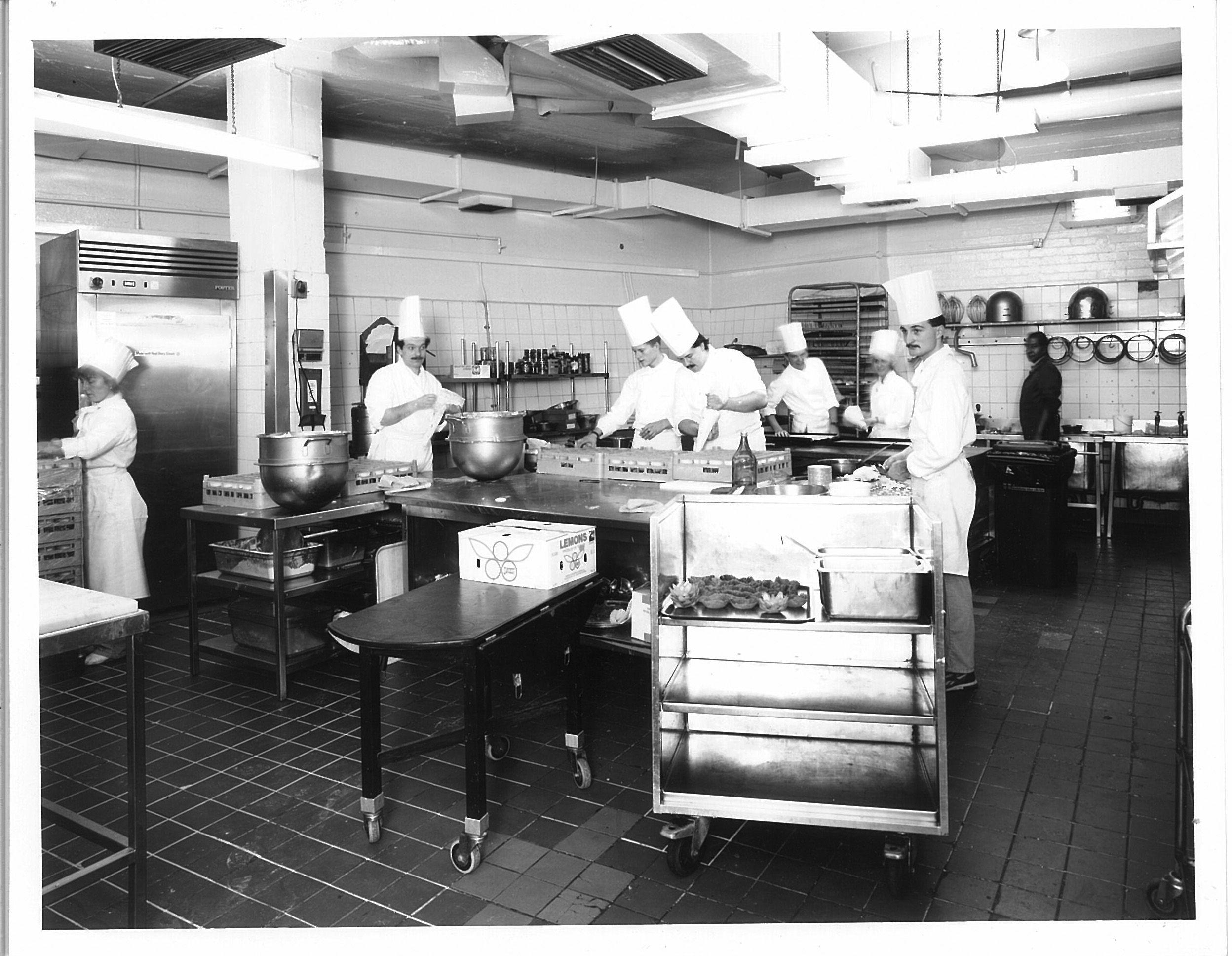 The chefs preparing for dinner service in The Dorchester\'s kitchen ...
