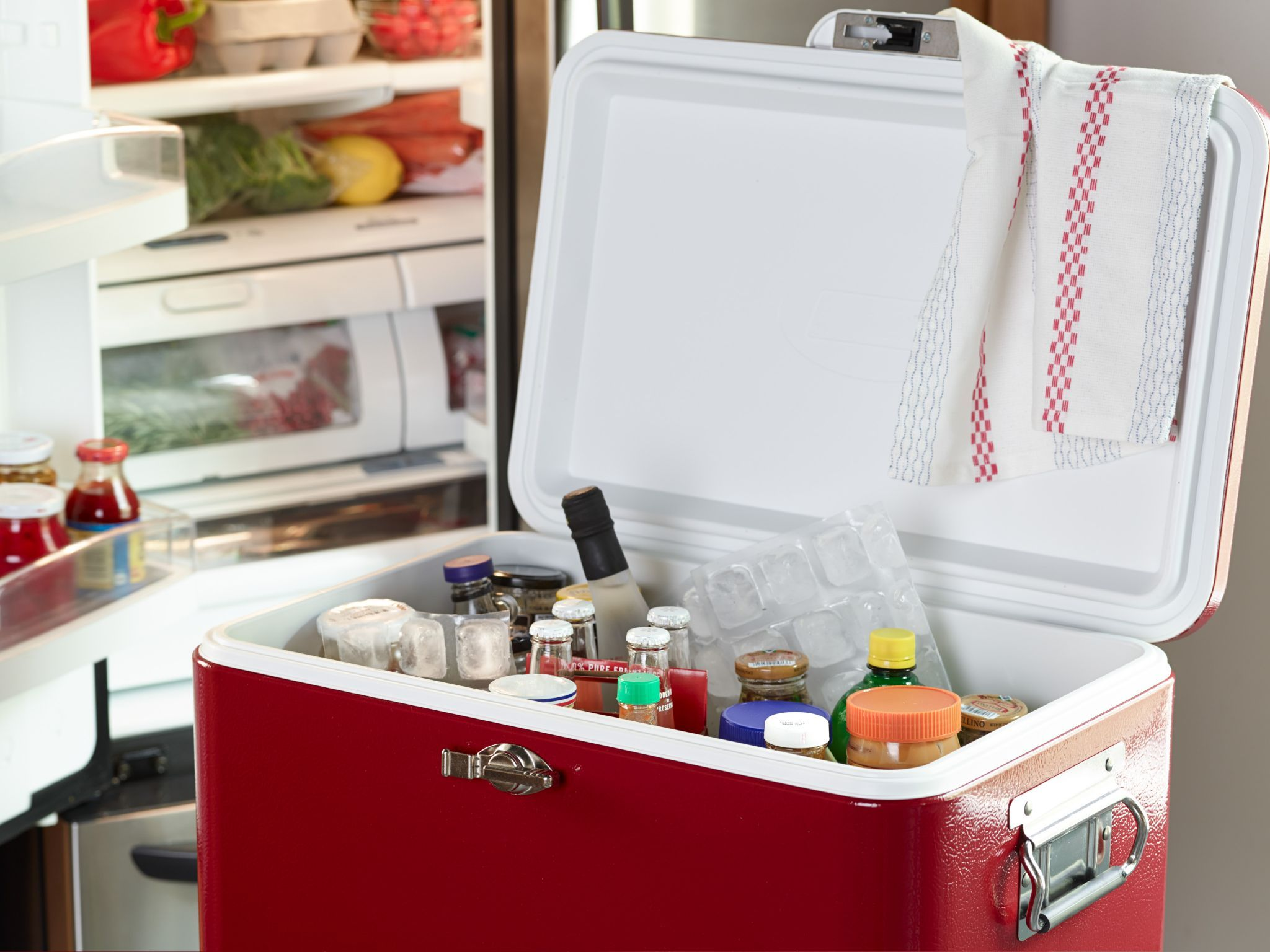 Ice Chest as a Fridge : In the lead-up to the big feast, refrigerator real estate is precious. Clear out those space-hogging bottles of dressing and pickles, and stow them in the garage in a cooler filled with ice packs. Other genius plays with this wonder box: Use it to brine your turkey overnight (make sure to add plenty of ice). Or treat it like a warming drawer